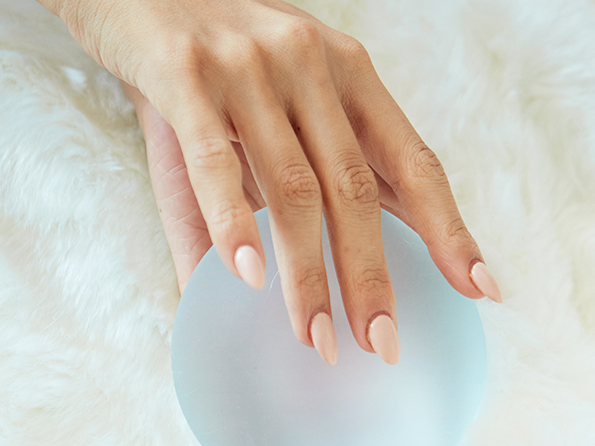 Hand holding implant