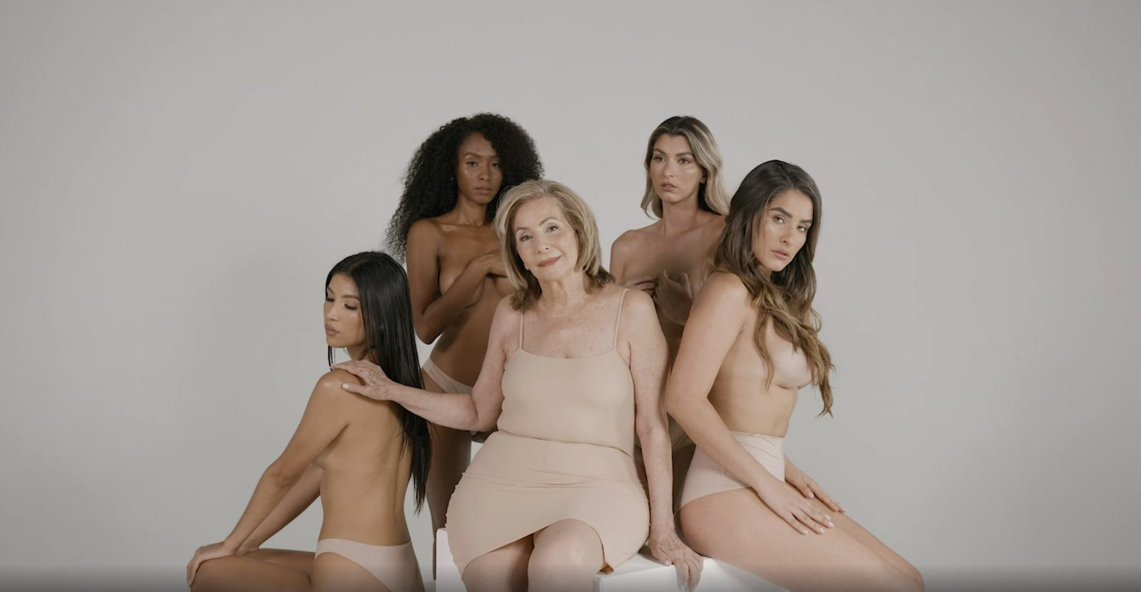 Women standing sitting together